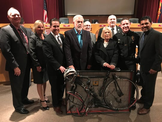Glendale city officials pose with the bicycle ridden by Brendan Lyons, executive director of non-profit organization Look! Save a Life, when he was hit by a distracted driver in October 2013. Lyons supported Glendale's move toward a cellphone ban.