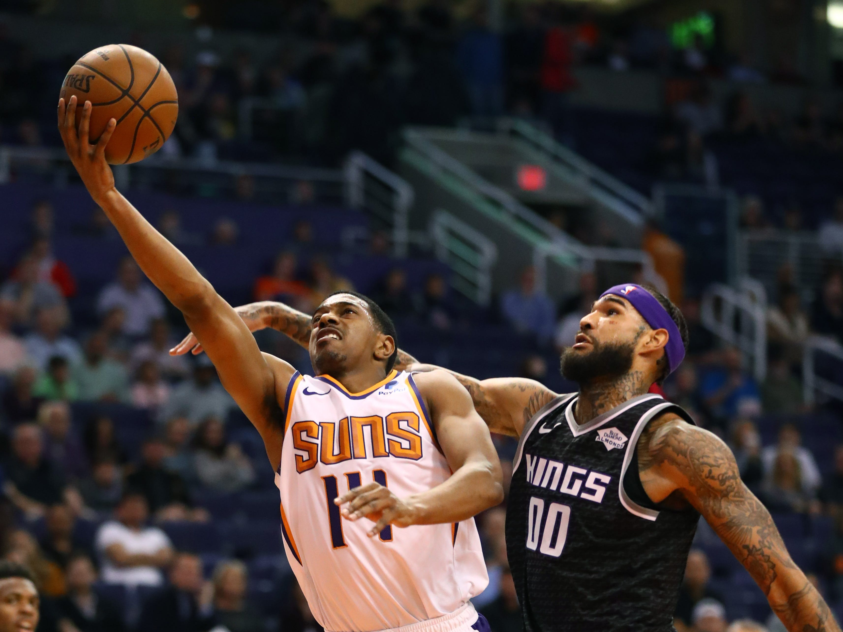 Jan 8, 2019; Phoenix, AZ, USA; Phoenix Suns guard De'Anthony Melton drives to the basket against Sacramento Kings center Willie Cauley-Stein in the first half at Talking Stick Resort Arena. Mandatory Credit: Mark J. Rebilas-USA TODAY Sports