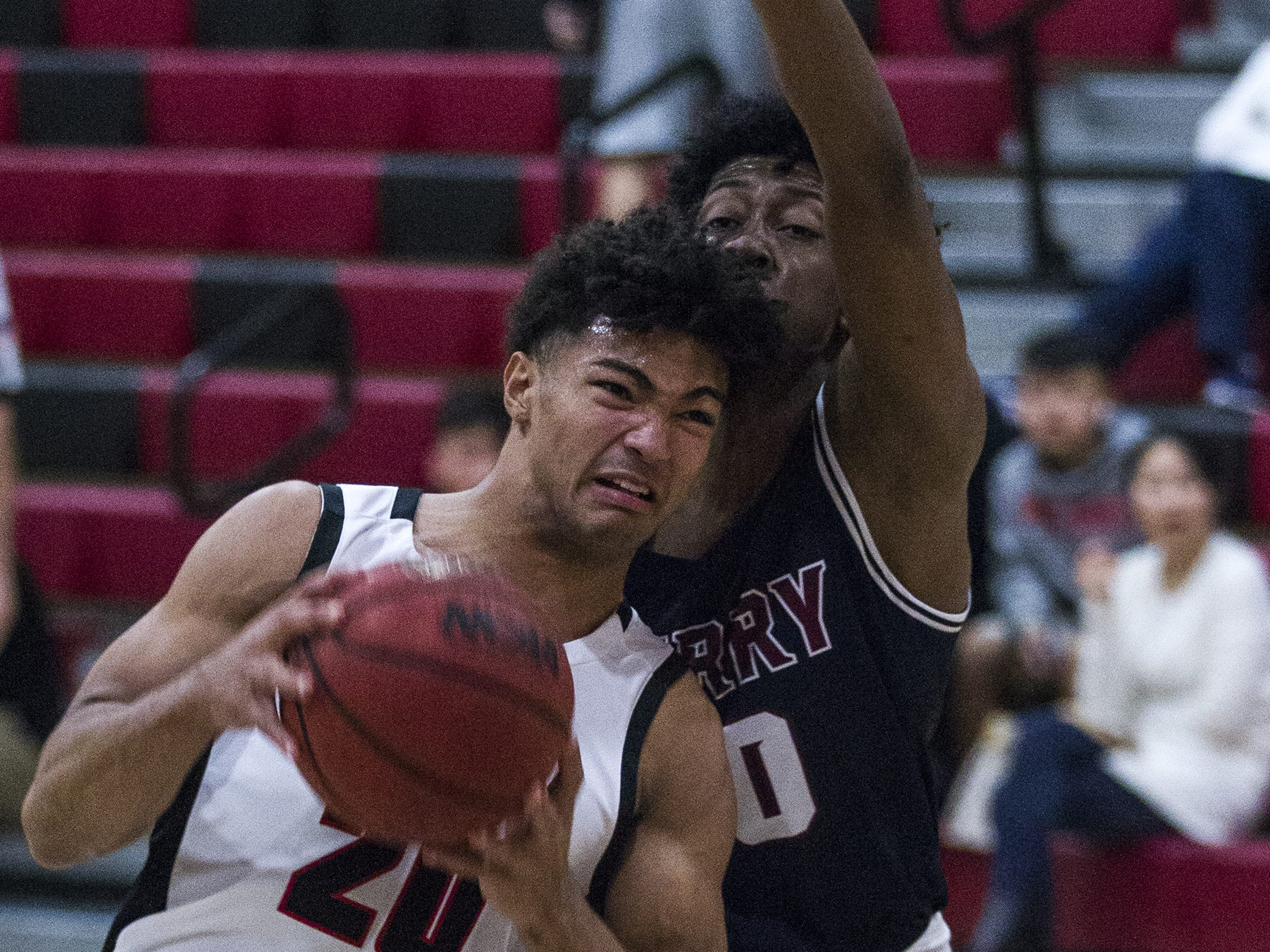 Brophy's Marques White gets body checked by Perry's Jalen Williams (10) during in the first half of their game at Brophy High School in Phoenix, Tuesday, Jan. 8, 2019.