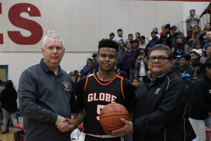 BJ Burries is one of only three players in Arizona prep history to score 3,000 career points. He's shown here with Burries with his coach James Simmons (left) and Globe Principal Robert Armenta.