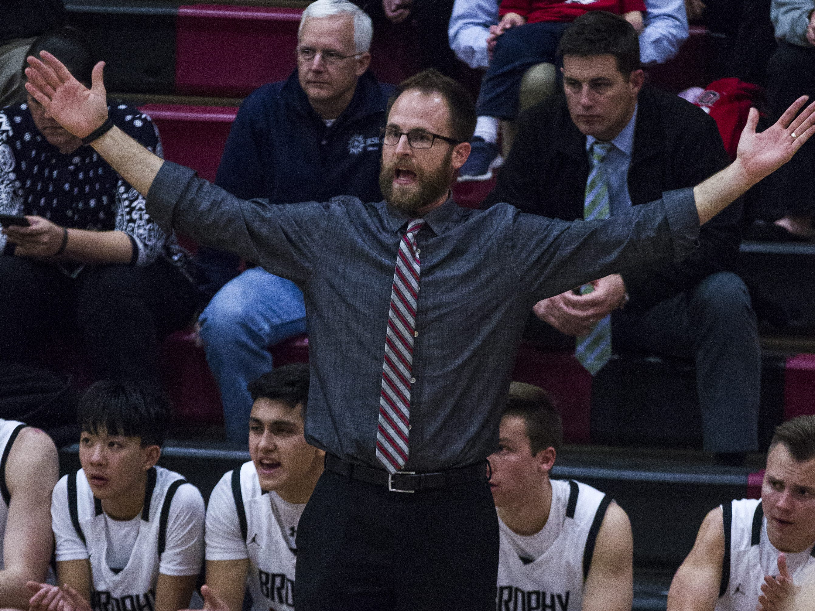 Brophy's coach Matt Hooten shouts out instructions to his team as they play Perry during in the first half of their game at Brophy High School in Phoenix, Tuesday, Jan. 8, 2019.