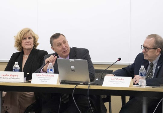 Arizona Department of Water Resources director Tom Buschatzke (center) speaks during a meeting on the proposed Colorado River Drought Contingency Plan in Phoenix on Jan. 8, 2019. At left is Leslie Meyers of the U.S. Bureau of Reclamation, and on the right is Ted Cooke, general manager of the Central Arizona Project.