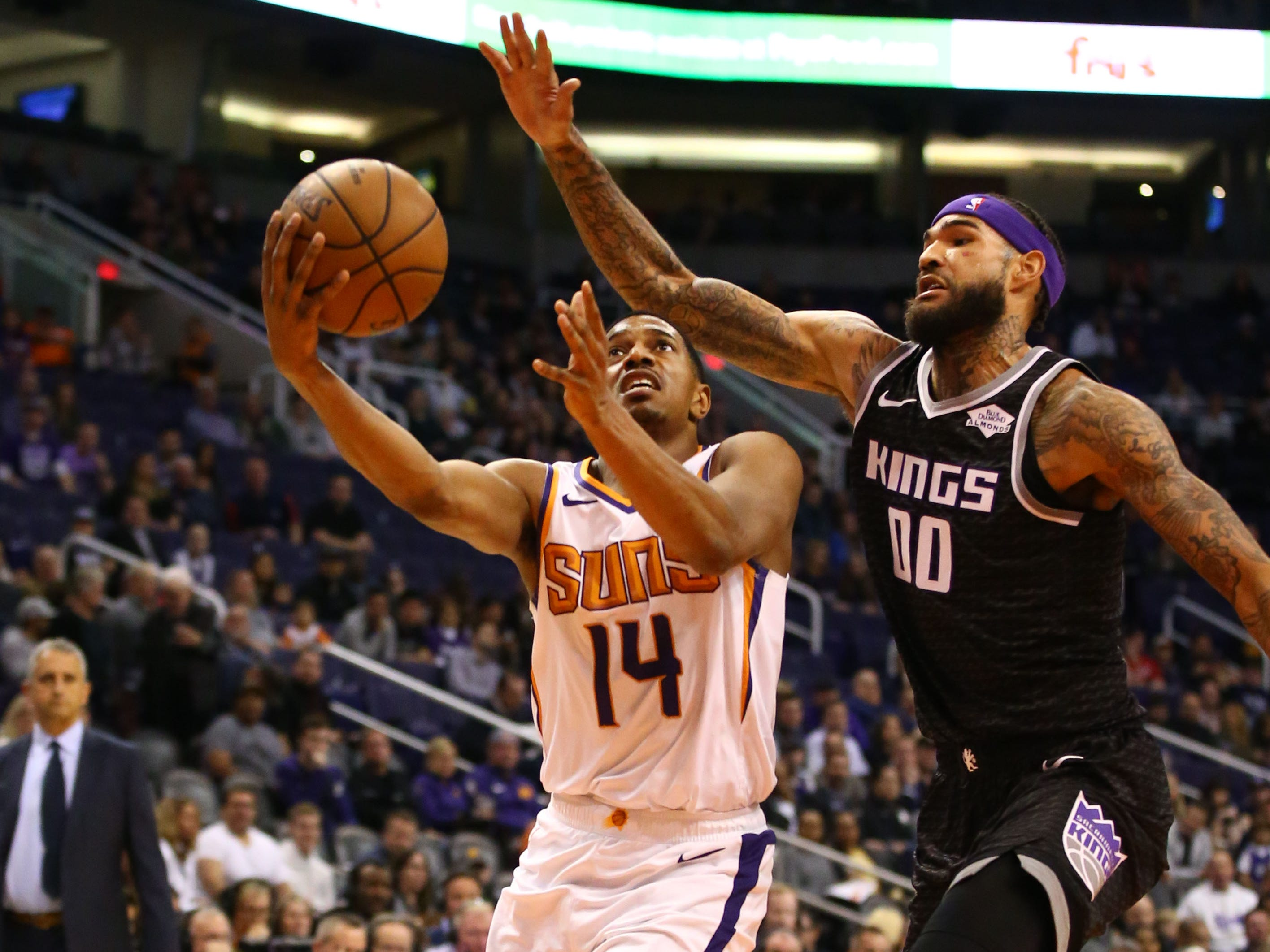 Phoenix Suns guard De'Anthony Melton is pressured by Sacramento Kings center Willie Cauley-Stein in the first half on Jan. 8 at Talking Stick Resort Arena.