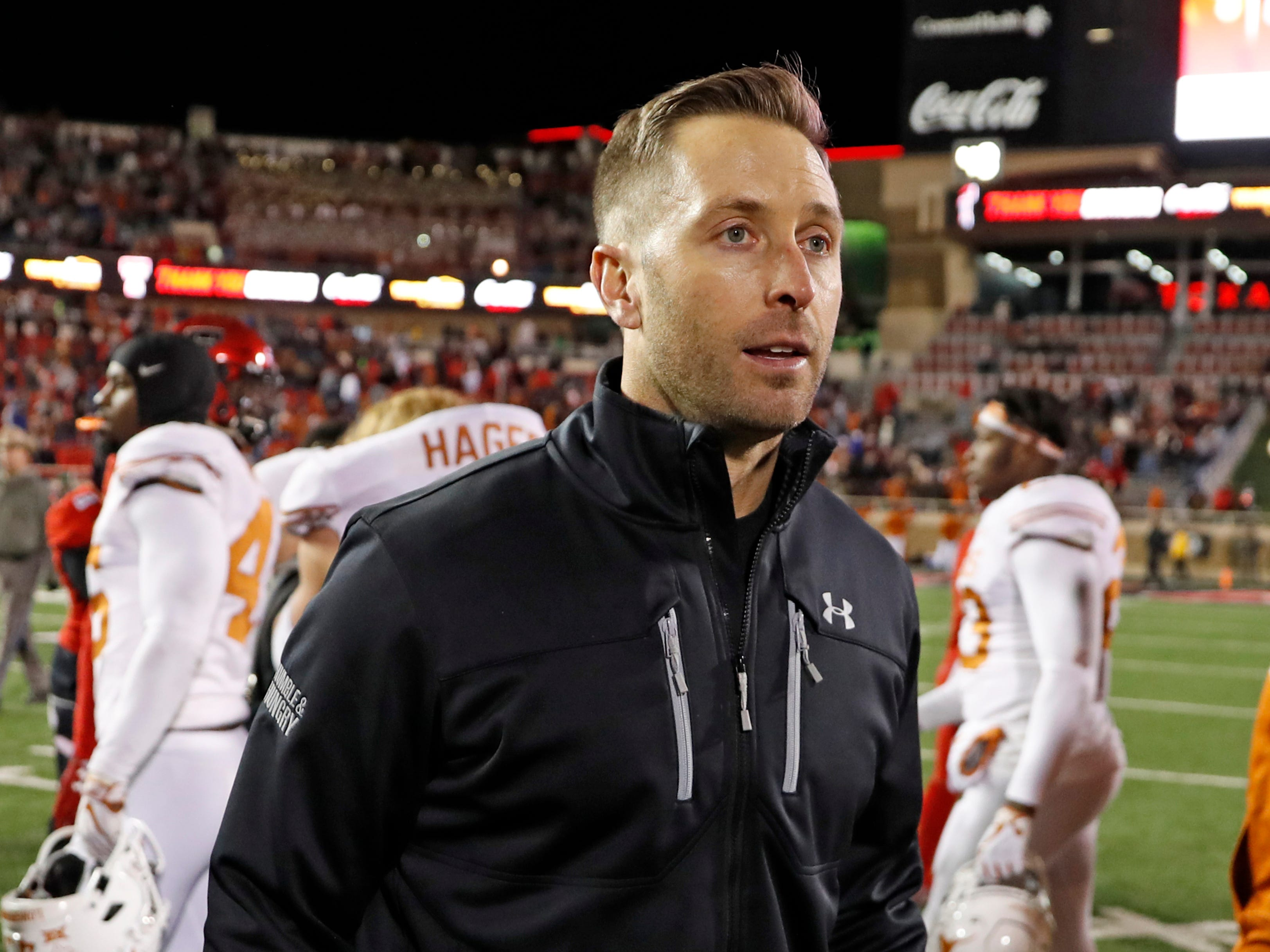 In this Nov. 10, 2018 file photo Texas Tech coach Kliff Kingsbury walks off the field after the team's NCAA college football game against Texas in Lubbock, Texas. The Arizona Cardinals have hired Kingsbury, a move aimed at providing guidance for young quarterback Josh Rosen and resuscitating the worst offense in the NFL. The Cardinals announced the hiring Tuesday, Jan. 8, 2018 after a long interview earlier in the day.