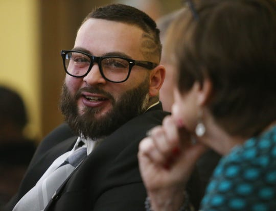 Chezzy Calenti speaks with resource coordinator Noreen Haddad during the graduation ceremony for the Dutchess County Court Judicial Diversion Program in the City of Poughkeepsie on January 9, 2019.