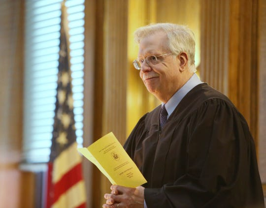 Judge Peter Forman addresses graduates and guests during the graduation ceremony for the Dutchess County Court Judicial Diversion Program in the City of Poughkeepsie on January 9, 2019.