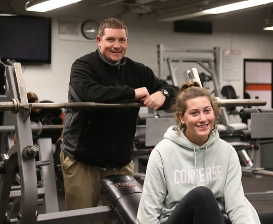 Marlboro High School weight thrower Kaitlyn Conte with her coach, Tom Fassel at the high school's weight room on January 8, 2019.