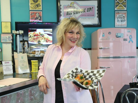 All Shook Up owner Michelle Michelle Morrill serves up a Little Egypt wrap with a 3 bean salad in the Arlington Business District on January 8, 2019.  All Shook Up offers healthy foods as well as several vegan/vegetarian options.
