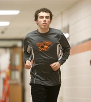 Marlboro High School long distance runner Braxxdon Dawson during his cool down routine following practice on January 8, 2019.