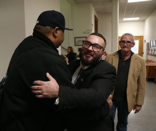 Chezzy Calenti hugs supporter Carlos Buchanan following the graduation ceremony for the Dutchess County Court Judicial Diversion Program in the City of Poughkeepsie on January 9, 2019.