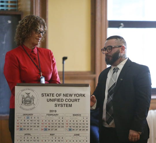 Probation officer Joan Salerno-Beach congratulates Chezzy Calenti during the graduation ceremony for the Dutchess County Court Judicial Diversion Program in the City of Poughkeepsie on January 9, 2019.