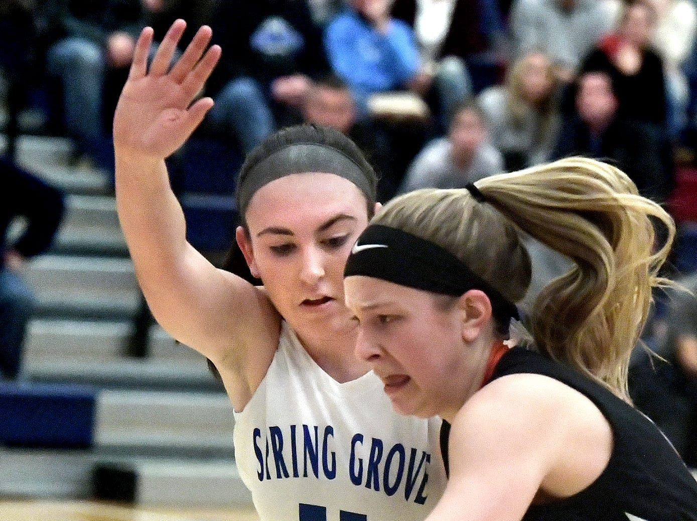 Spring Grove's Haley Wagman keeps pace with Central York's Katie Markel during basketball action at Spring Grove Tuesday, Jan. 8, 2019. Bill Kalina photo