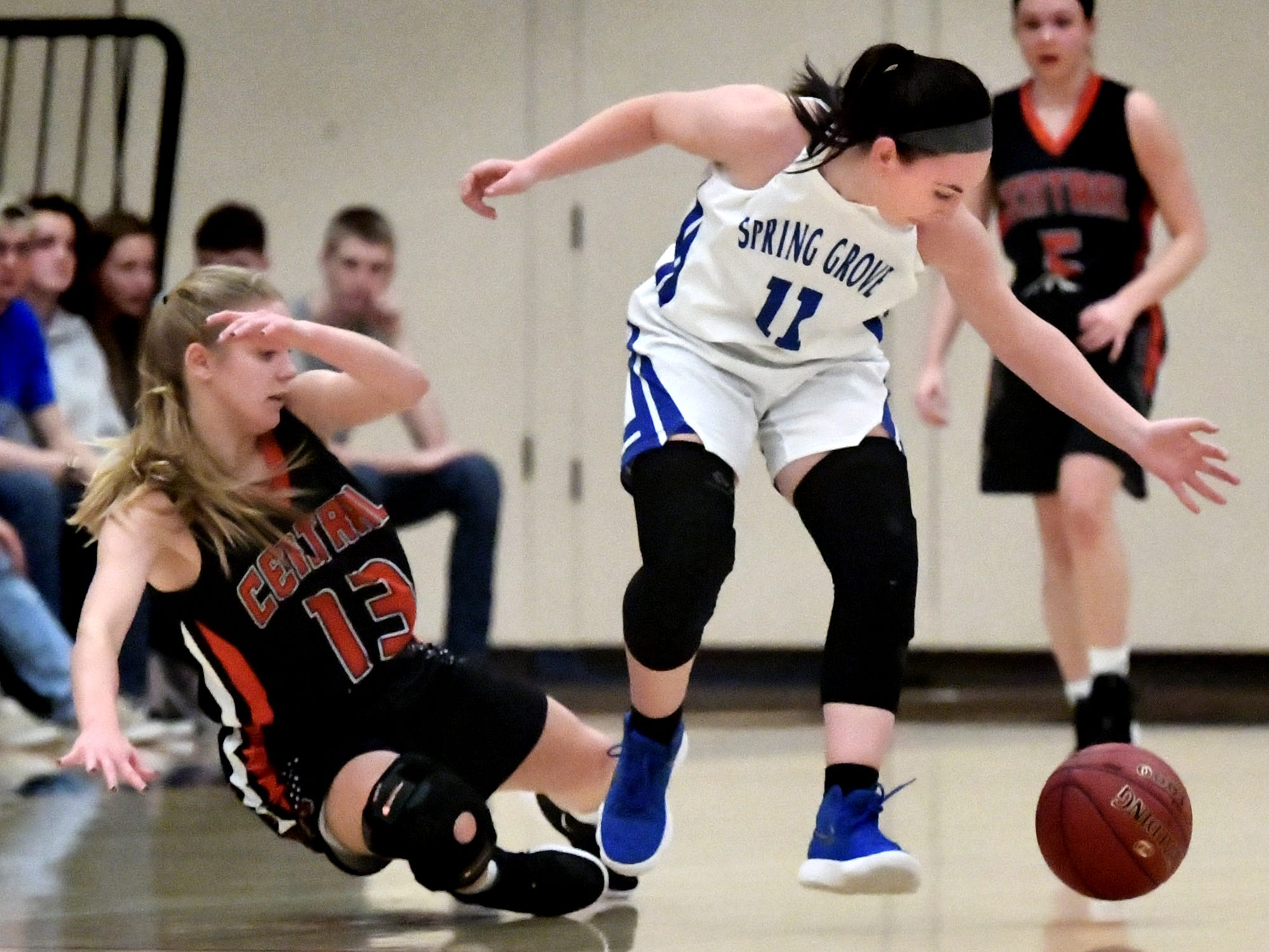 Spring Grove's Haley Wagman and Central York's Grayce Rothrock collide while chasing a loose ball during basketball action at Spring Grove Tuesday, Jan. 8, 2019. Bill Kalina photo