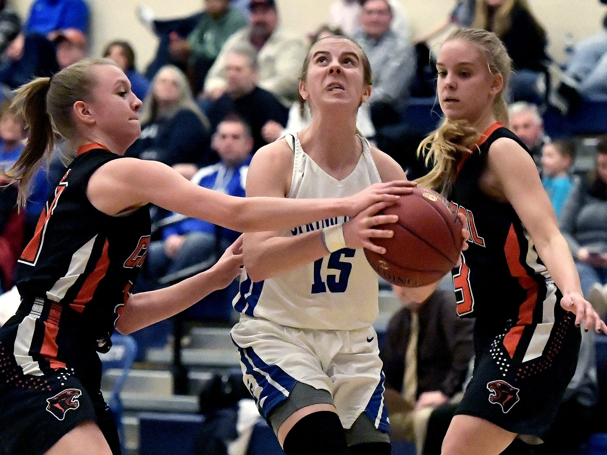 Spring Grove's Lexi Hoffman drives past Central York's Makaela Frey, left, and Grayce Rothrock during basketball action at Spring Grove Tuesday, Jan. 8, 2019. Bill Kalina photo