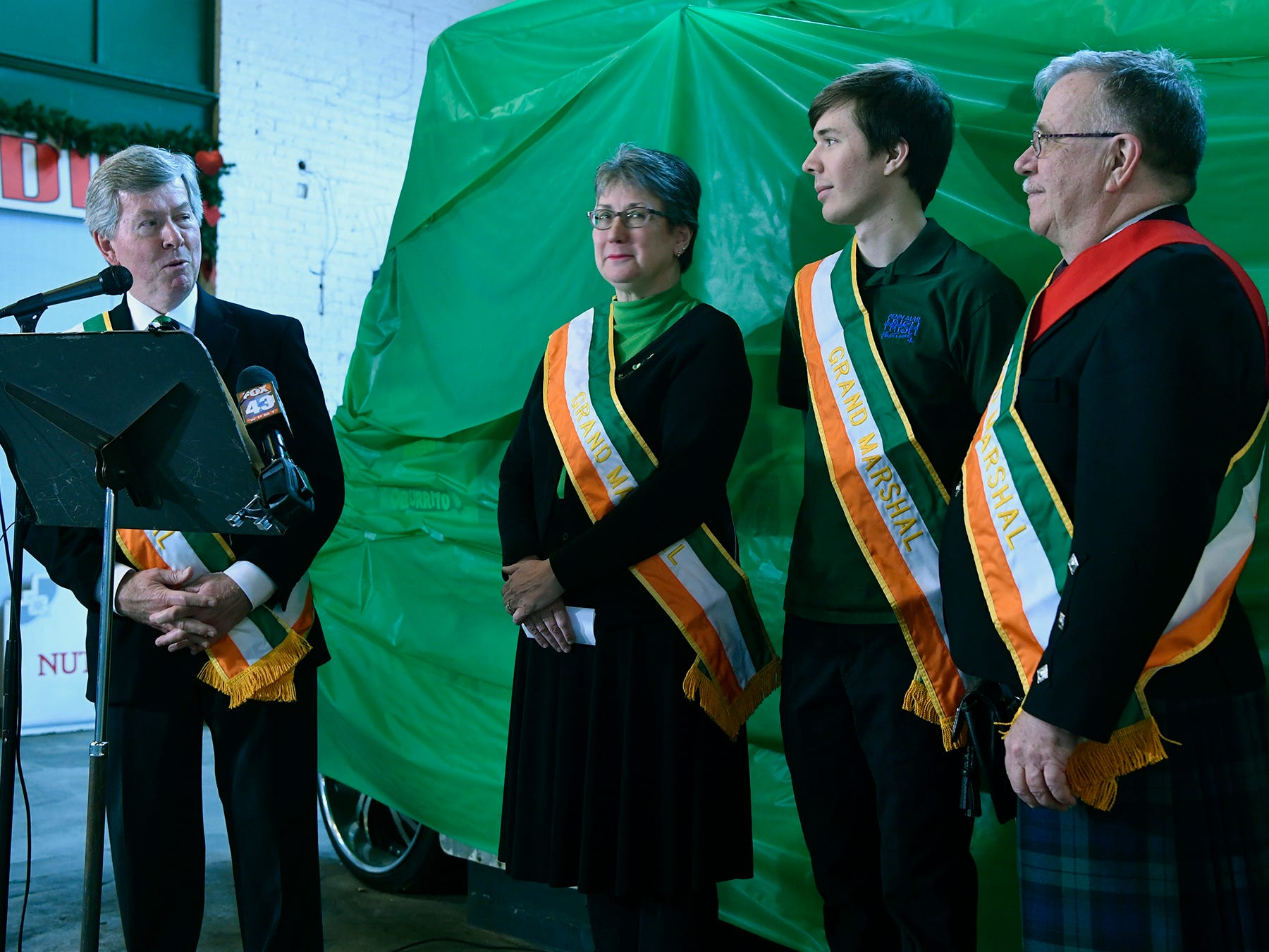 2018 Grand Marshal Dave Kennedy, left, introduces the Yeaple family, Mary, Jay and Rodney, right, as the Grand Marshal family for the 36th Annual York Saint Patrick's Day Parade, Wednesday, January 9, 2019. The parade will be held Saturday, March 16. John A. Pavoncello photo