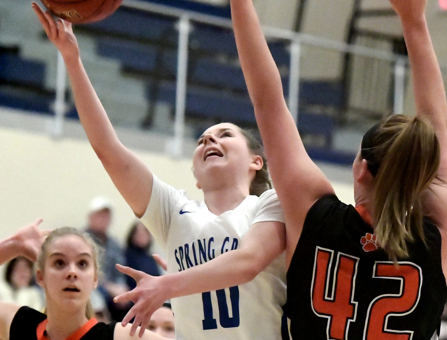 Spring Grove's Ellie Glass drives to the basket past Central York's Emily Prowell during basketball action at Spring Grove Tuesday, Jan. 8, 2019. Bill Kalina photo