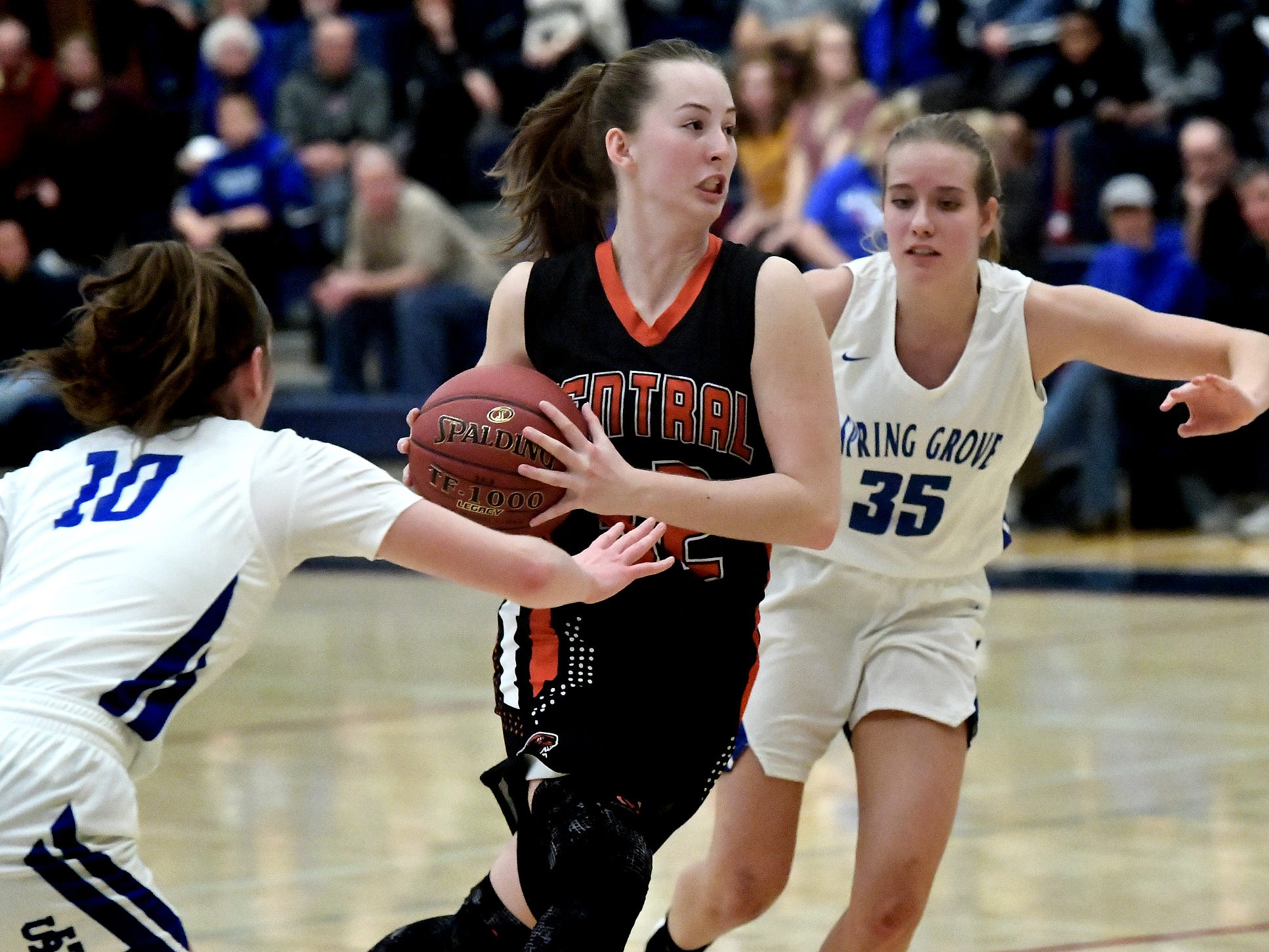Central York's Kara Davies drives with Spring Grove's Ellie Glass, left, and Brooklyn Naylor defending during basketball action at Spring Grove Tuesday, Jan. 8, 2019. Bill Kalina photo