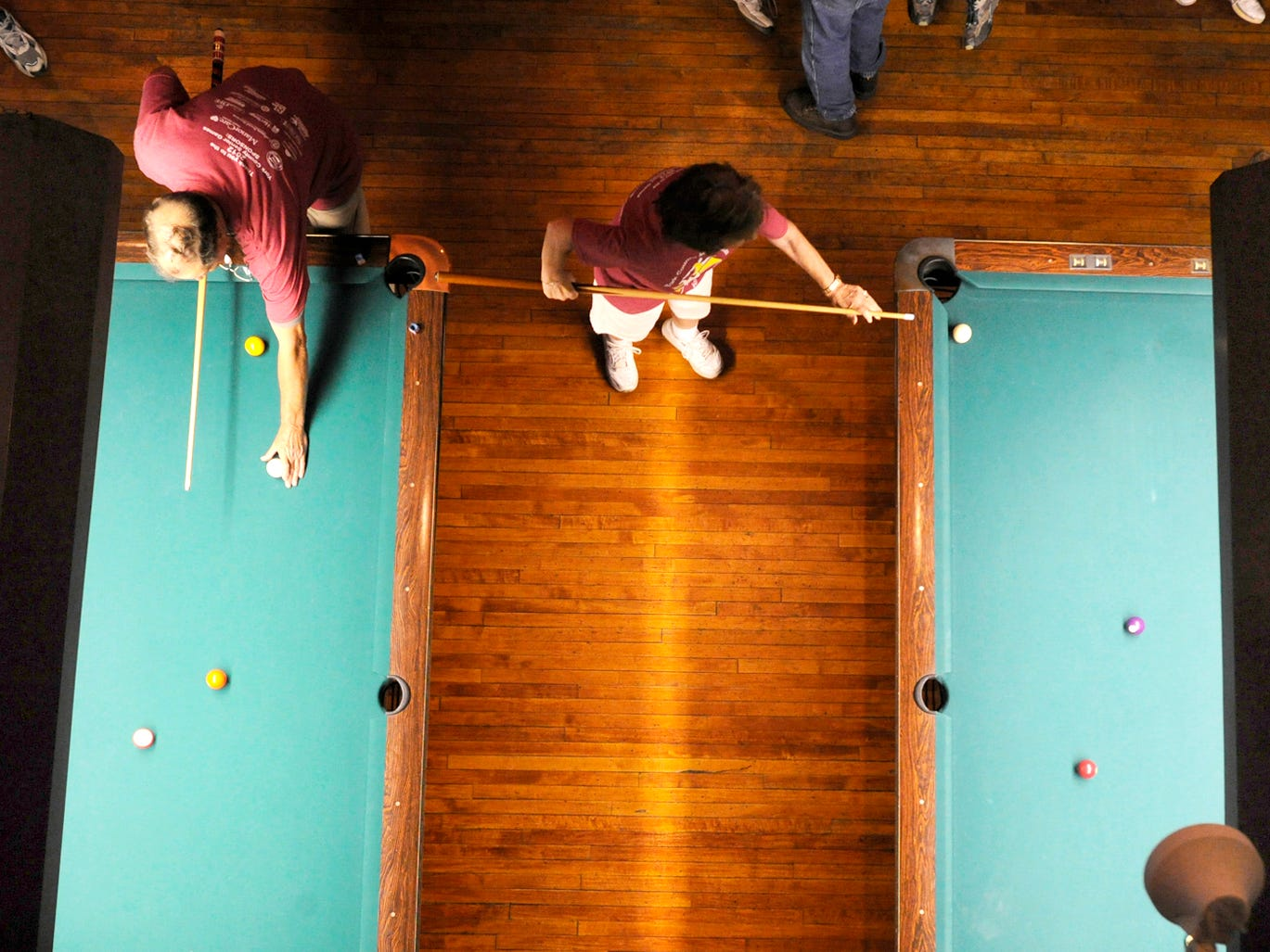 Terry Reinhard, left, of Shiloh and Toni Stankiewicz of Dallastown, practice before the start of the billiards tournament at the York County Senior Games at Cobblestones on June 18, 2012.