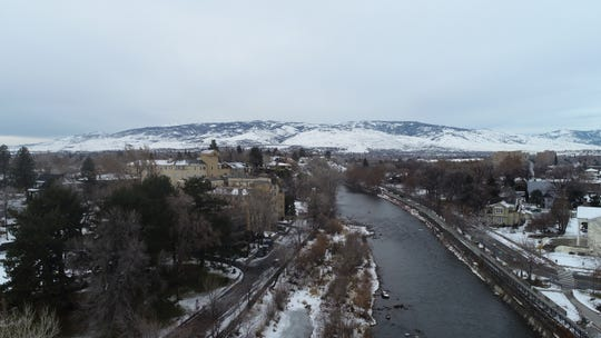 Snow lines the Truckee River in downtown Reno on Tuesday, Jan. 8.