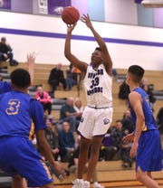 Spanish Springs' Cordell Stinson (33) shoots while taking on Lincoln during their basketball game in Reno on Jan. 4.
