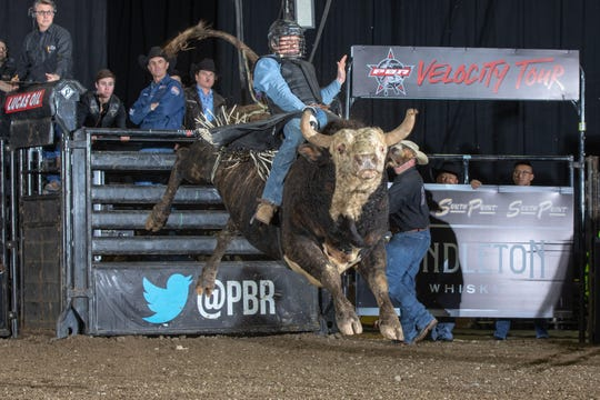 Cody Casper attempts to ride Western Madness of Flying U / Cindy Rosser during the Round 2 ( Short-Go ) of the PBR Velocity Tour event in Oakland.