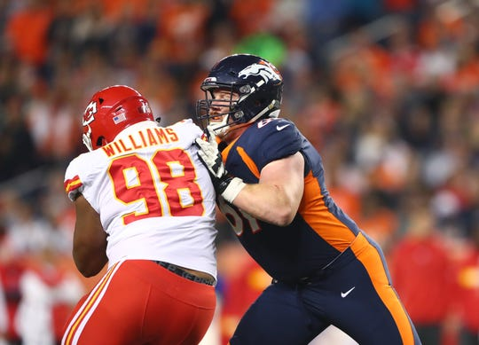 Denver Broncos center Matt Paradis (61) against Kansas City Chiefs defensive tackle Xavier Williams (98).
