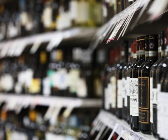 Wine bottles line the shelves of Pinnacle Wine and Liquor in Brighton.