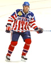 Defenseman Doug Janik averaged more than 100 penalty minutes in each of his five Amerks seasons.