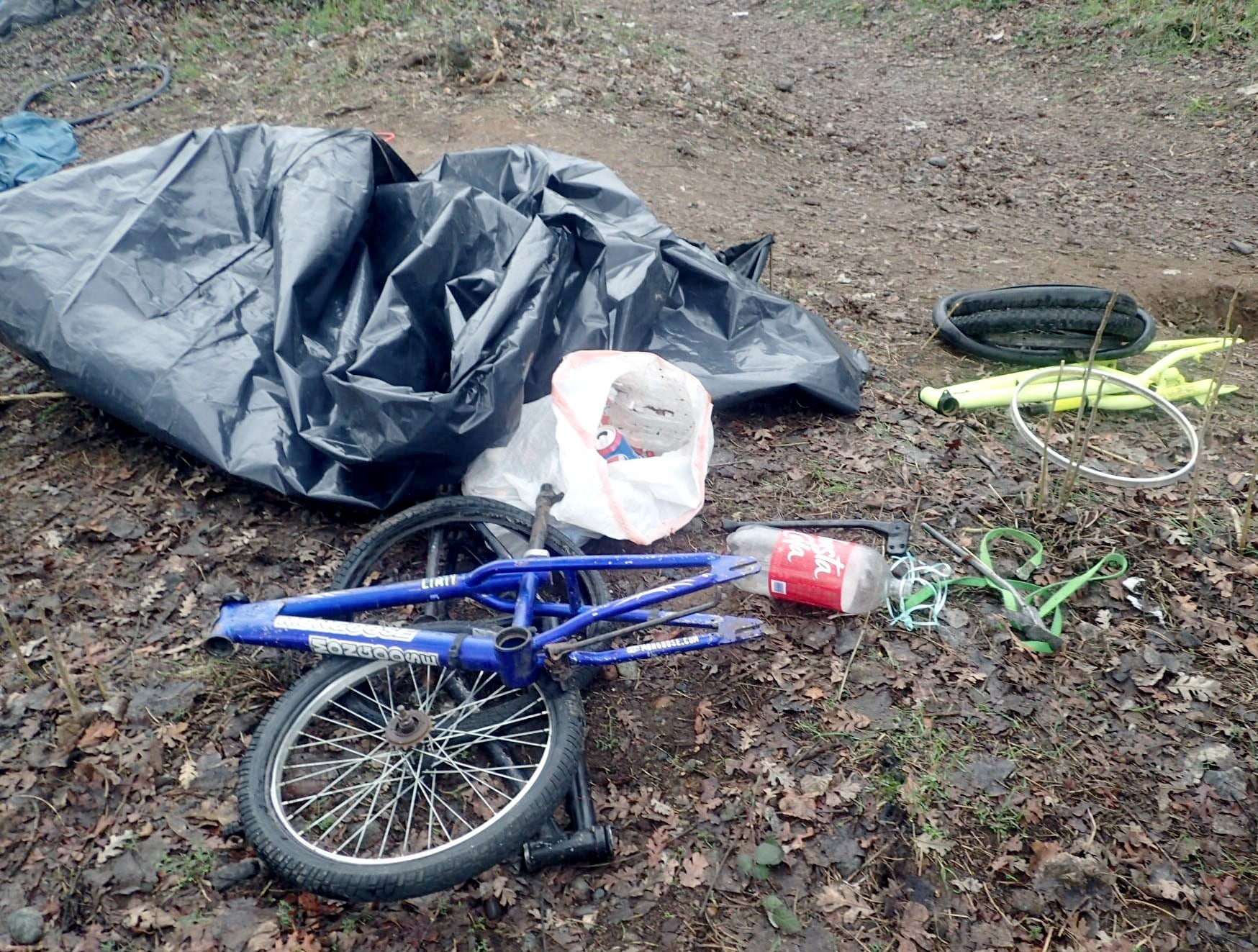 Bike parts and tarps were found near the Sacramento River on Jan. 8, 2019, and removed by cleanup workers.