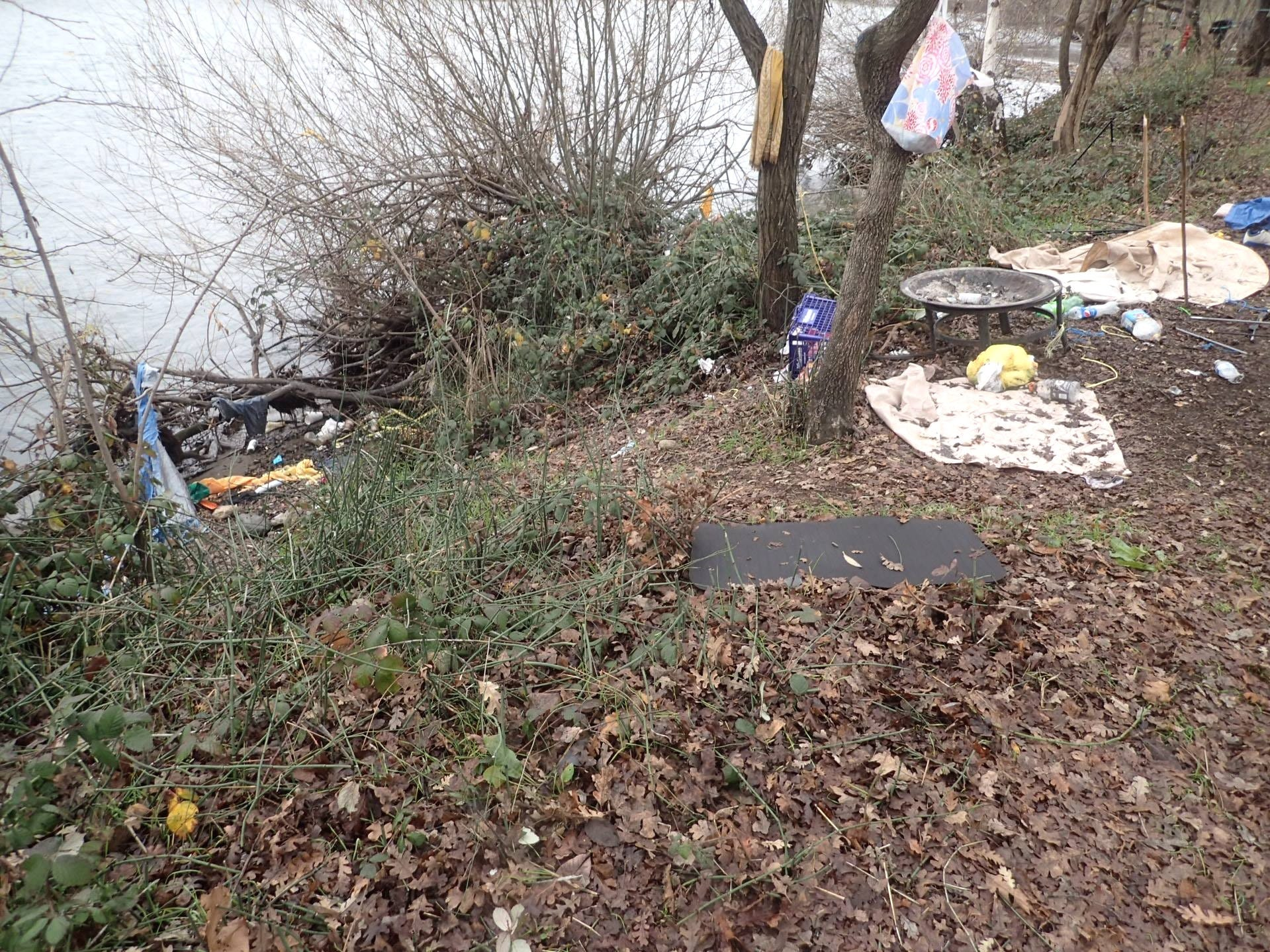 Trash left behind by homeless campers was removed Jan. 8, 2019, in a camp cleanup operation along the Sacramento River in Redding.