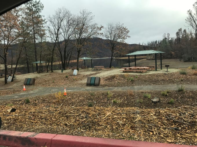 There were no overflowing trash containers at the Whiskey Creek picnic area on Monday.