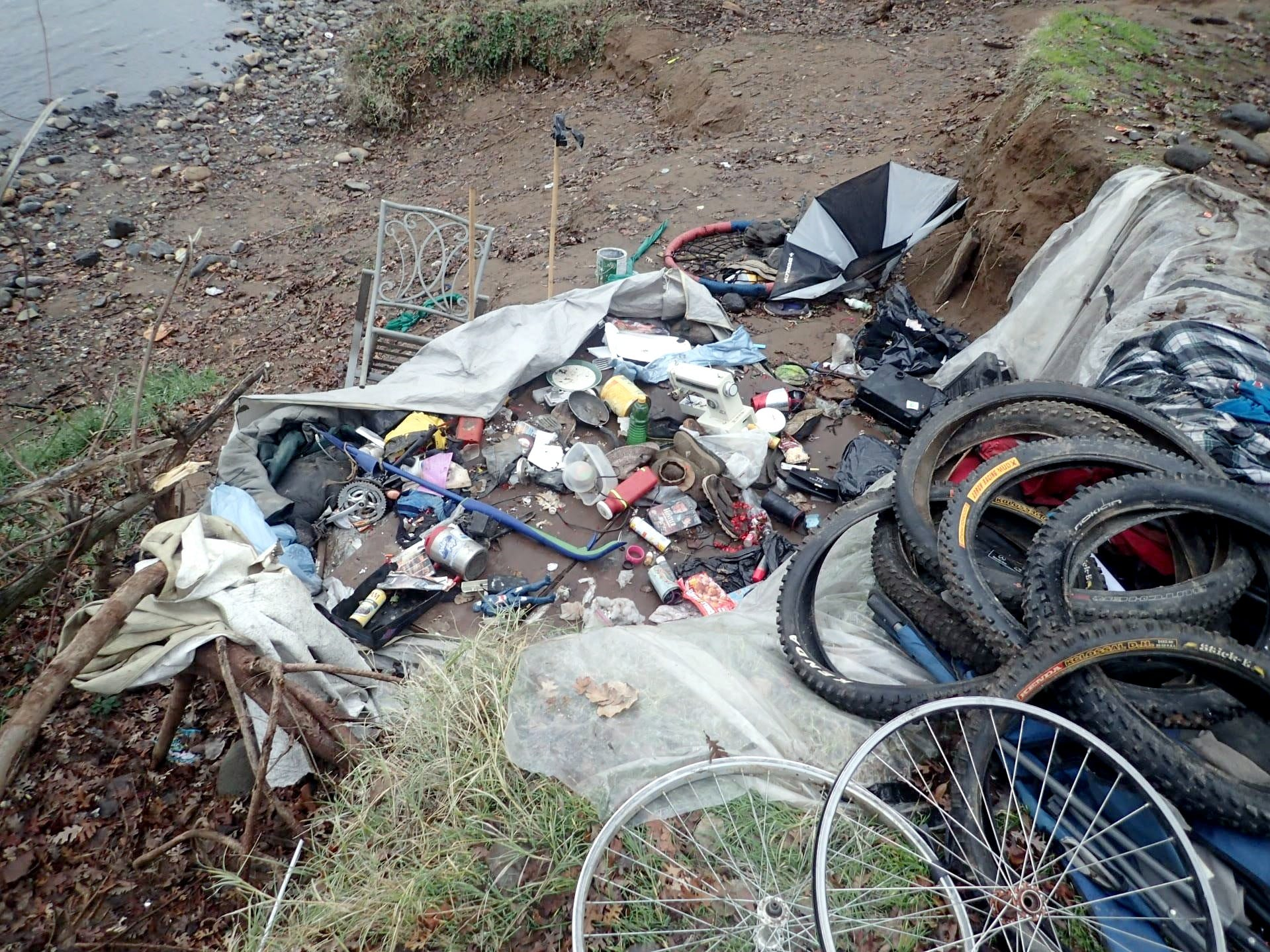 Bicycles tires and other bike parts were among items removed on the banks of the Sacramento River on Jan. 8, 2019, in Redding.