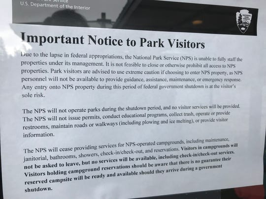A notice attached to the outside of the Whiskeytown National Recreation Area Visitor's Center reminds people of the impacts of the federal government shutdown.