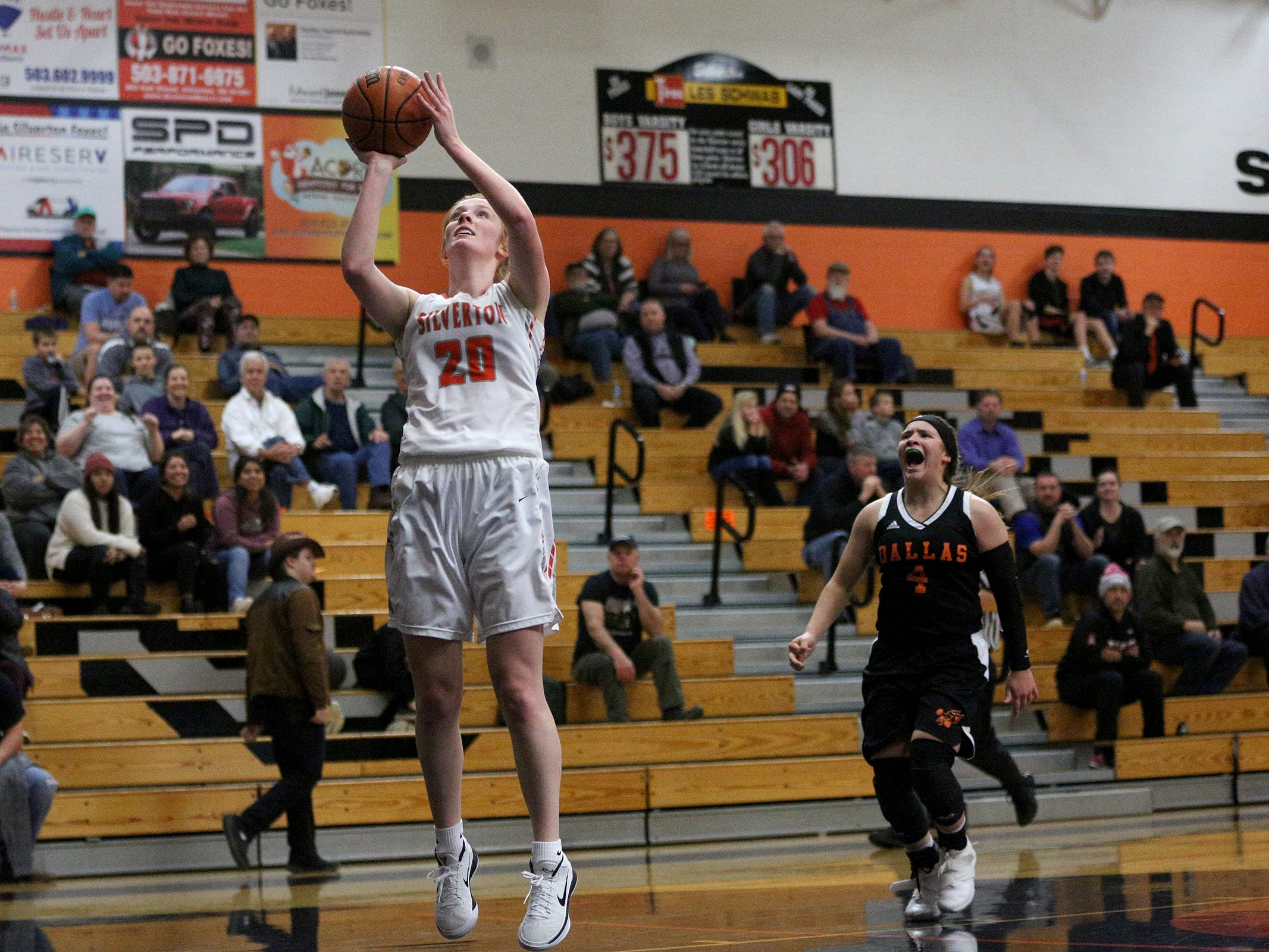 Junior Riley Traeger (20) attempts a layup during the Dallas High School vs. Silverton High School girls basketball game in Silverton on Tuesday, Dec. 8, 2019.