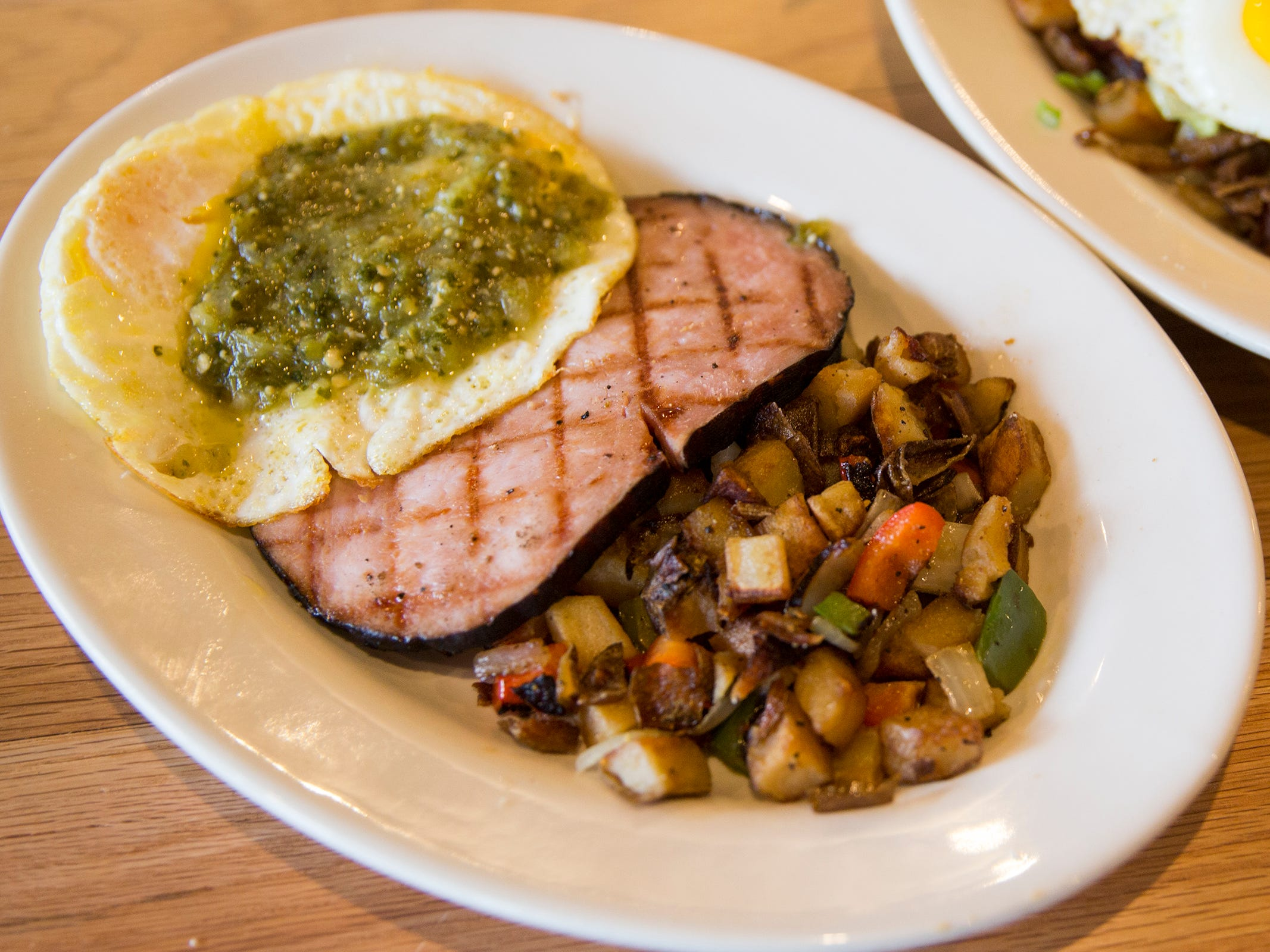 Green eggs and ham which has eggs with salsa verde, ham steak and hash browns at Black Sheep Café & Catering in Salem on Tuesday, Dec. 8, 2019.