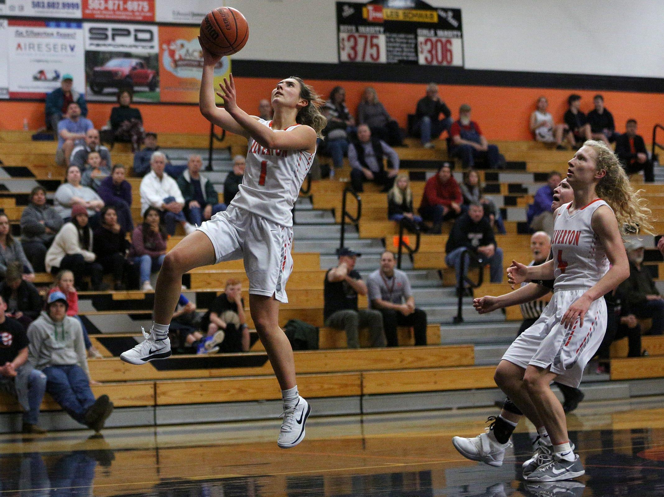 Silverton's Jori Paradis (1) goes for the basket during the Dallas High School vs. Silverton High School girls basketball game in Silverton on Tuesday, Dec. 8, 2019.
