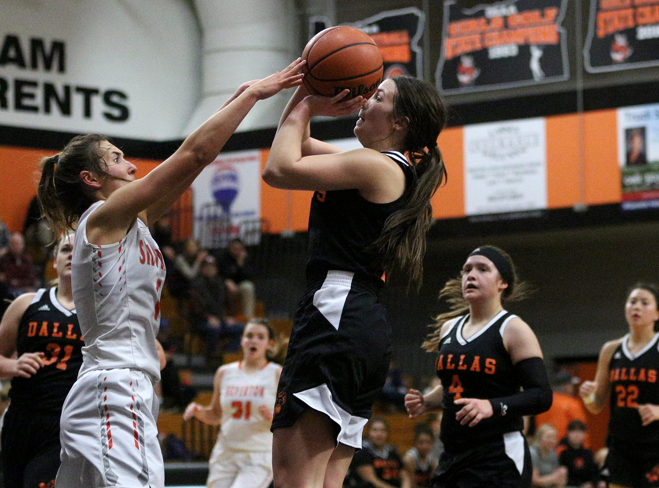 Dallas' Emma Classen (3) protects the ball against Silverton's defense during the Dallas High School vs. Silverton High School girls basketball game in Silverton on Tuesday, Dec. 8, 2019.