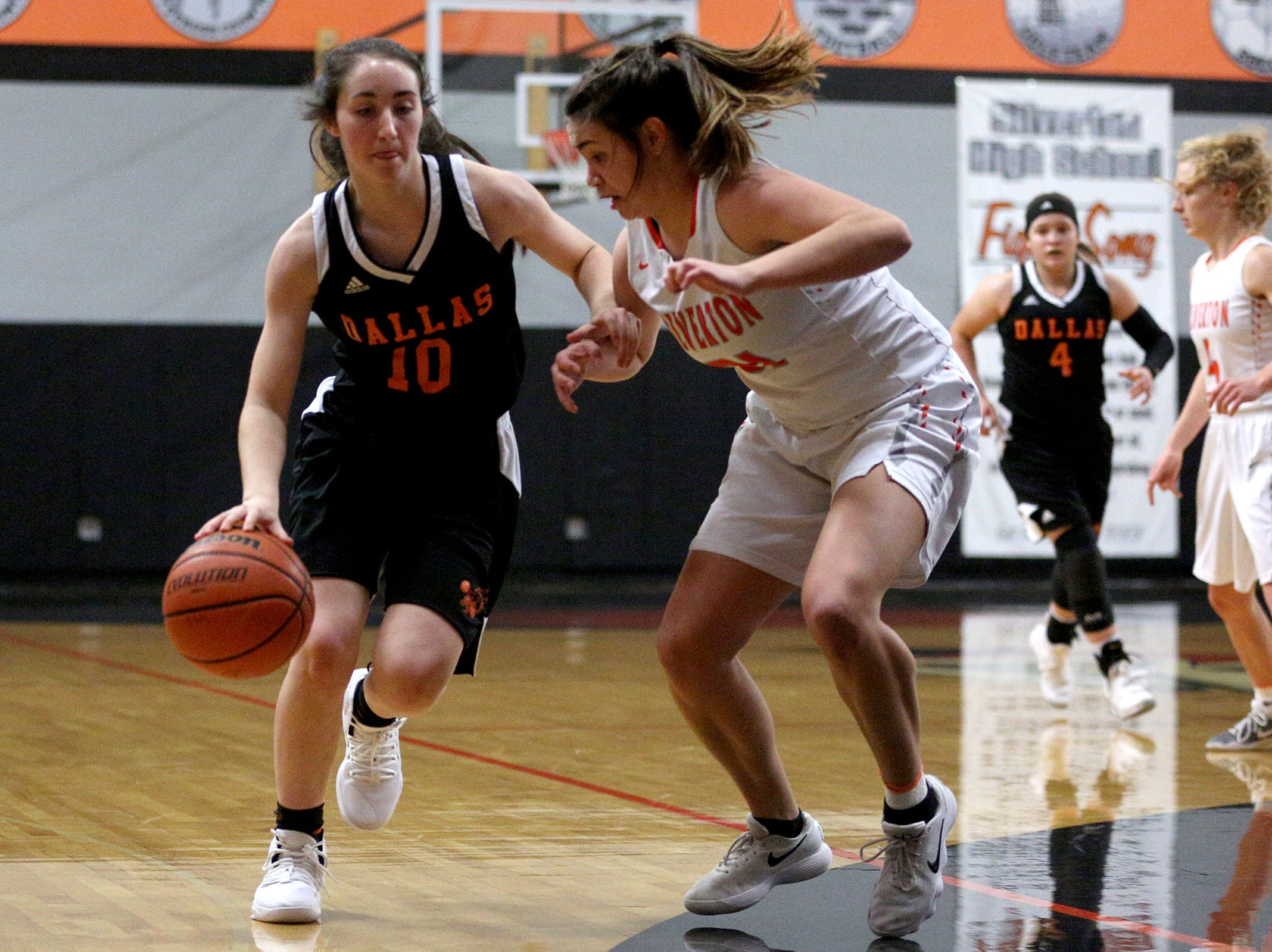 Dallas' Madelyn Loughary (10) makes her way around Silverton's defense during the Dallas High School vs. Silverton High School girls basketball game in Silverton on Tuesday, Dec. 8, 2019.