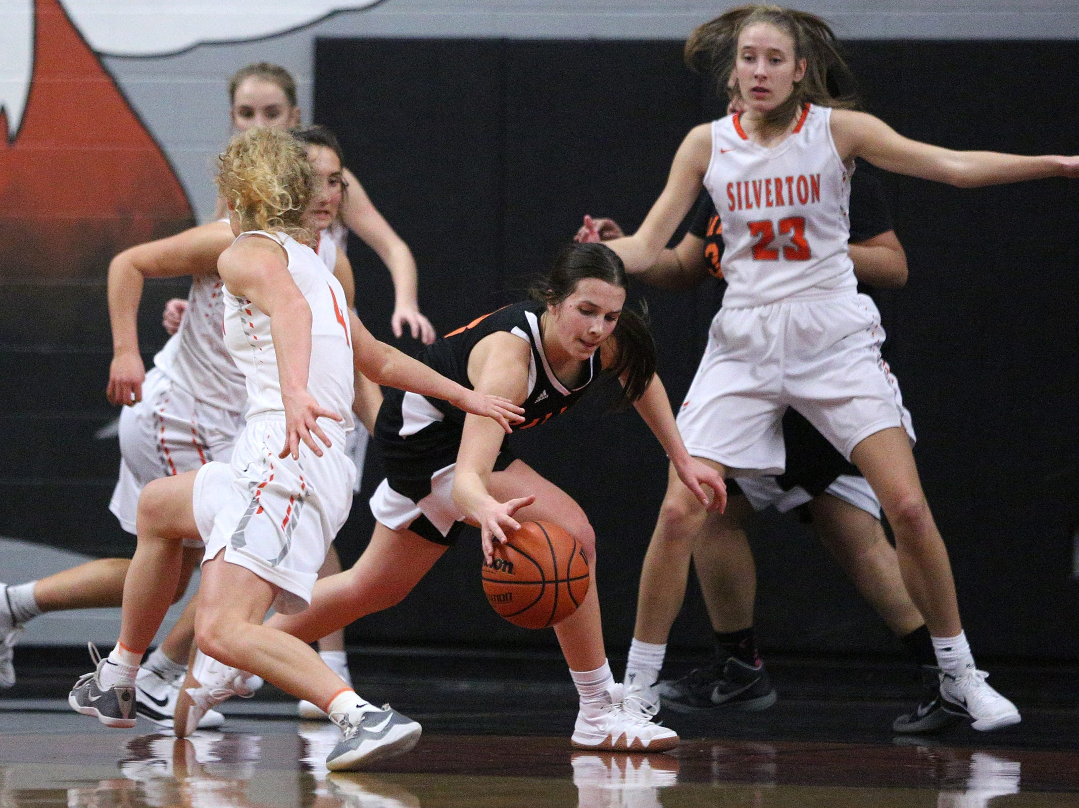Dallas' Emma Classen (3) protects the ball during the Dallas High School vs. Silverton High School girls basketball game in Silverton on Tuesday, Dec. 8, 2019.