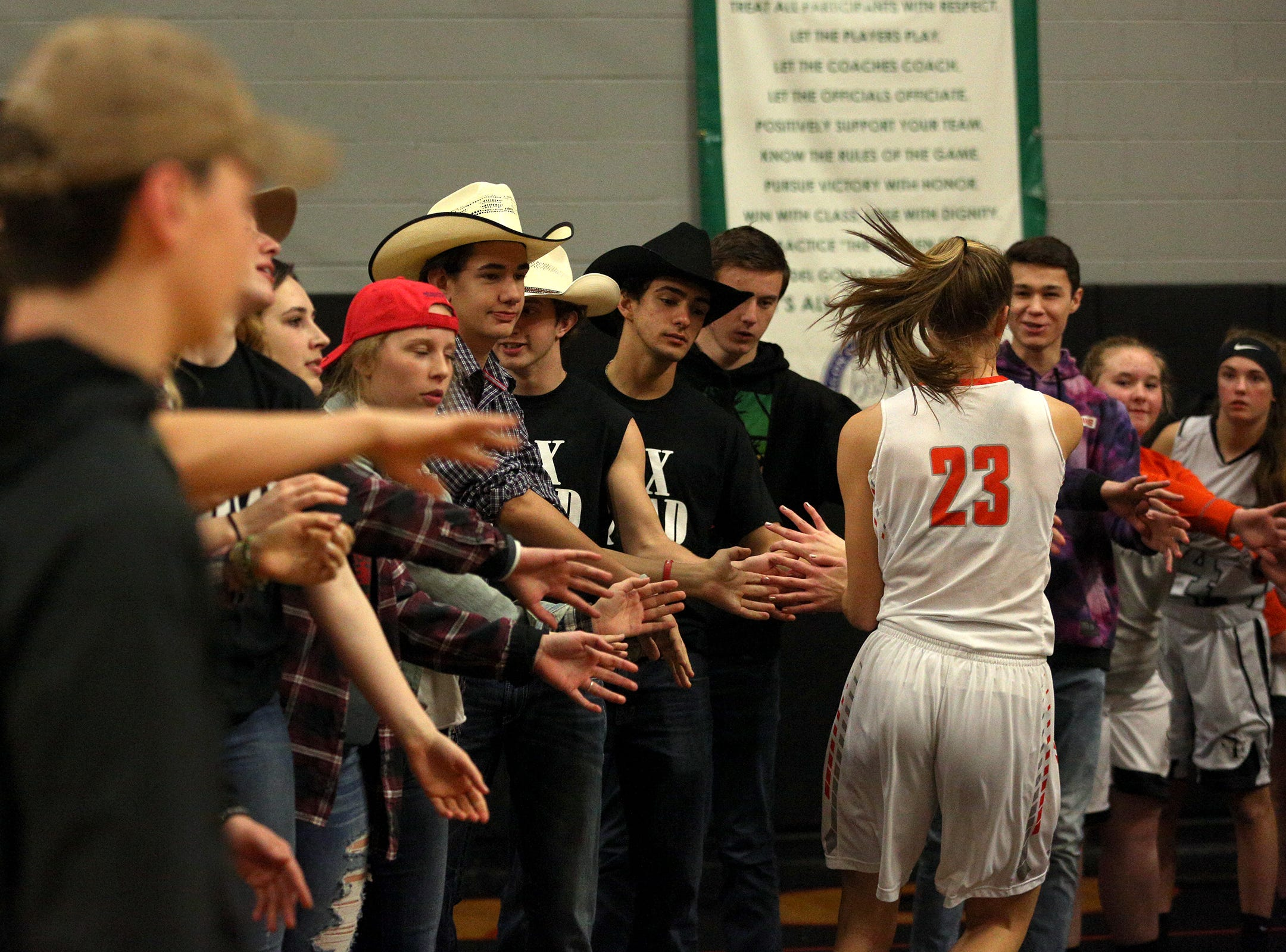 Silverton's Truitt Reilly high fives the student section before the Dallas High School vs. Silverton High School girls basketball game in Silverton on Tuesday, Dec. 8, 2019.