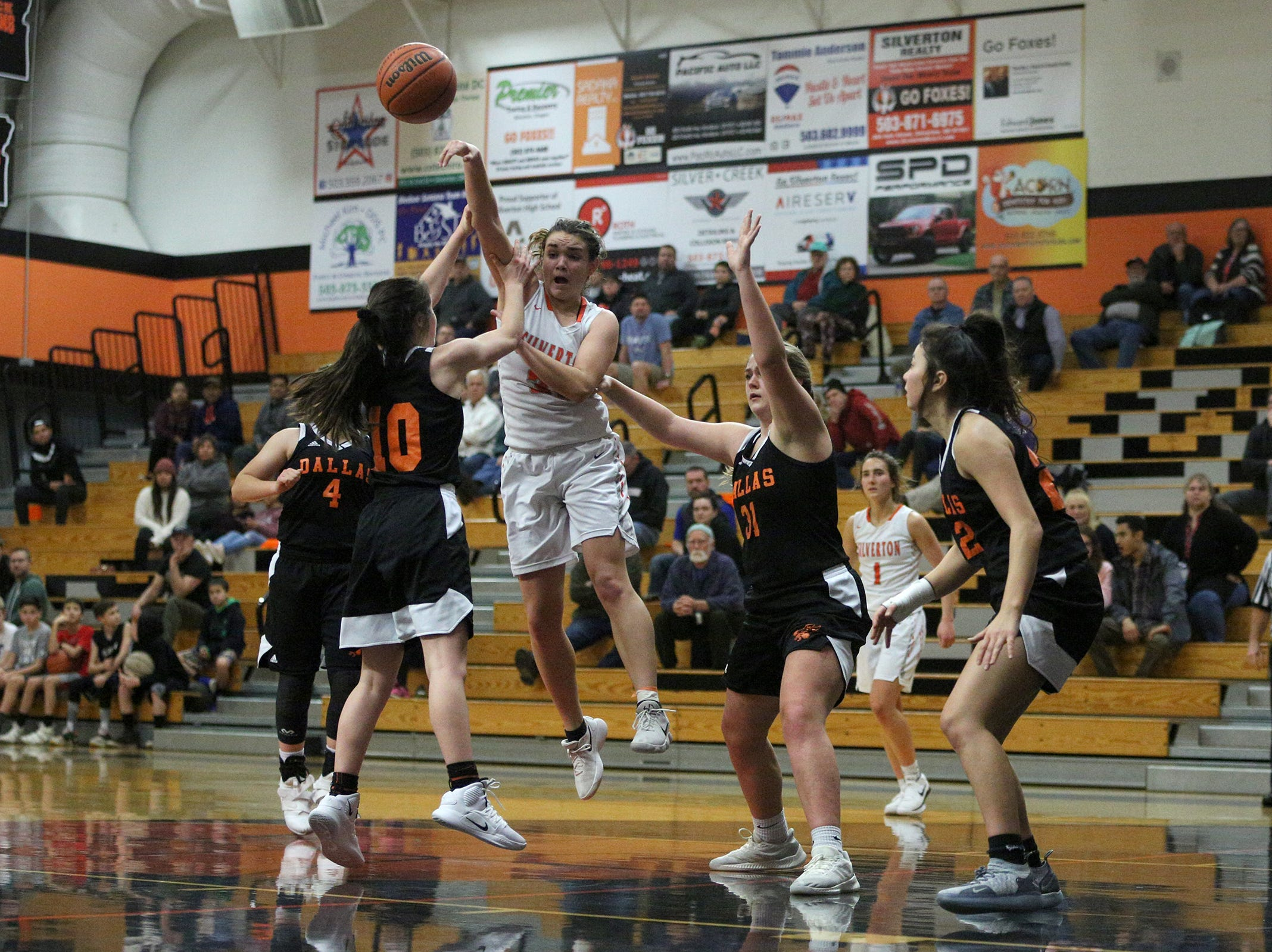 Silverton's Lilly Horner (11) goes up for a past during the Dallas High School vs. Silverton High School girls basketball game in Silverton on Tuesday, Dec. 8, 2019.