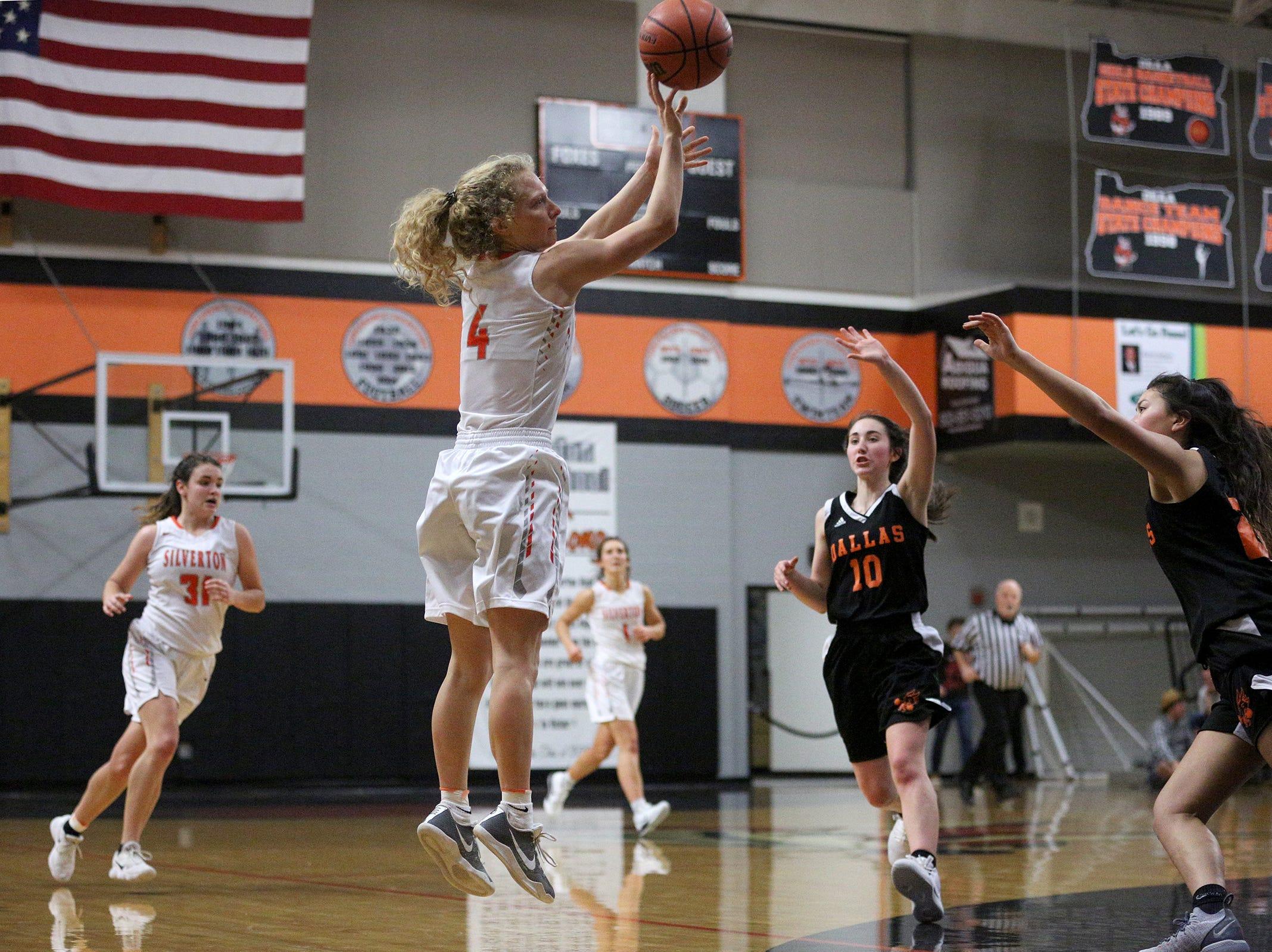 Silverton's Ellie Schmitz (4) attempts a shot during the Dallas High School vs. Silverton High School girls basketball game in Silverton on Tuesday, Dec. 8, 2019.