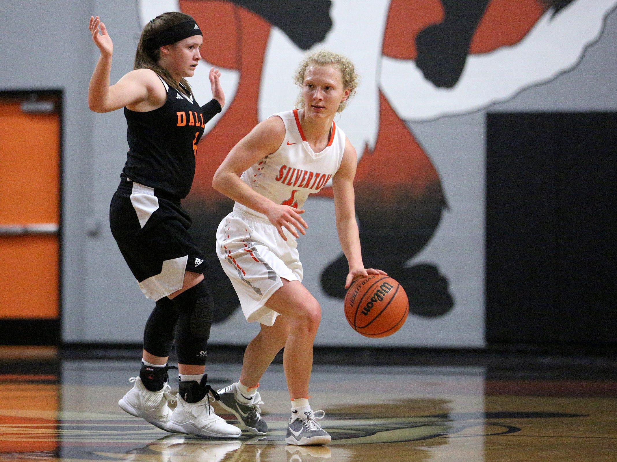 Silverton's Ellie Schmitz (4) gets around Dallas' defense during the Dallas High School vs. Silverton High School girls basketball game in Silverton on Tuesday, Dec. 8, 2019.