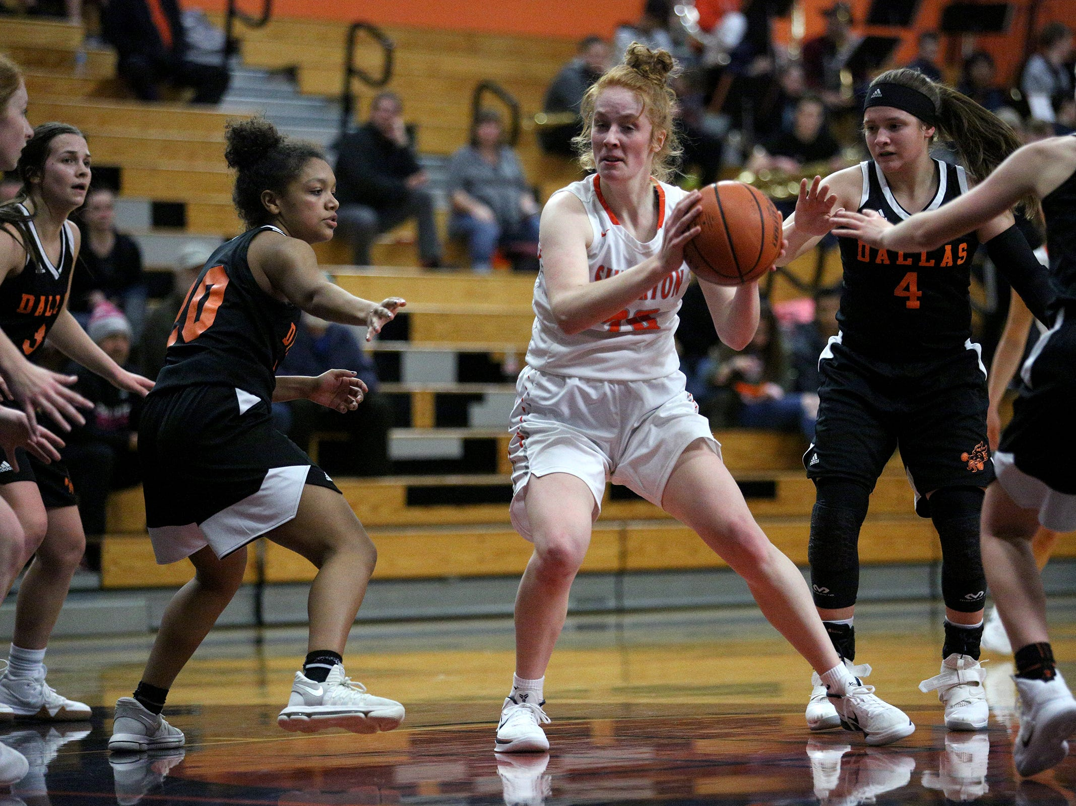 Silverton's Riley Traeger (20) protests the ball during the Dallas High School vs. Silverton High School girls basketball game in Silverton on Tuesday, Dec. 8, 2019.