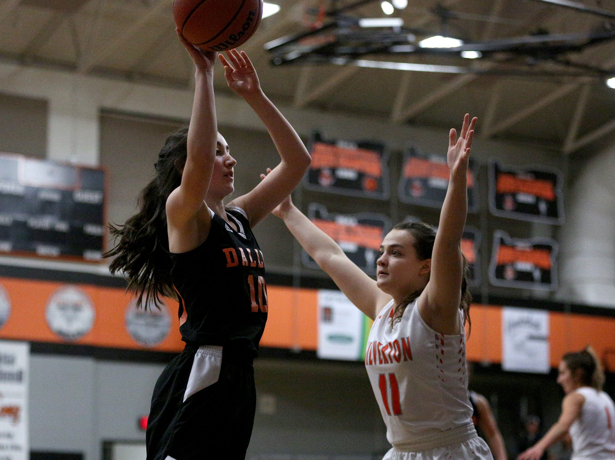 Silverton's Lilly Horner (11) works to block Dallas' Madelyn Loughary (20) during the Dallas High School vs. Silverton High School girls basketball game in Silverton on Tuesday, Dec. 8, 2019.