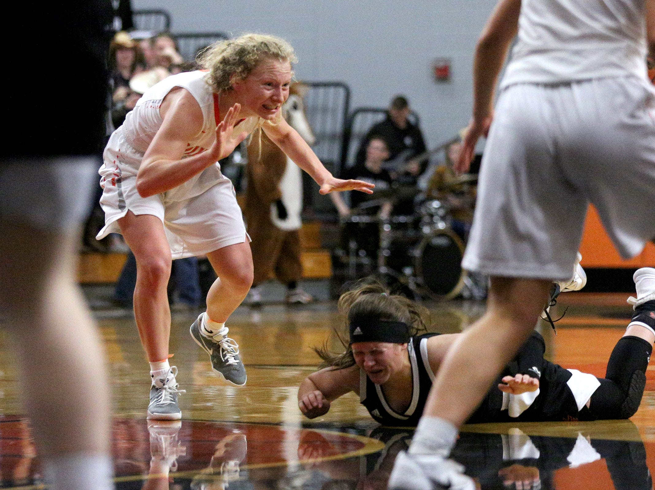 Dallas' Maddie Doig (4) falls after losing the ball during the Dallas High School vs. Silverton High School girls basketball game in Silverton on Tuesday, Dec. 8, 2019.
