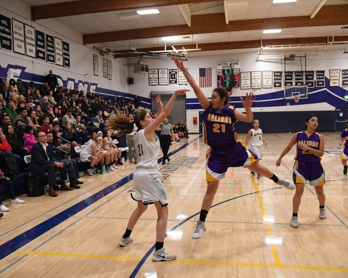 Salinas forward Christina Chagnon (21) closes out on Notre Dame's Grace Briley (21) as she shoots a corner 3-pointer.