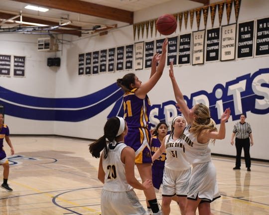 Chagnon (21) was an integral part of two Cowboys teams (girls' volleyball and basketball) with perfect league records this season.