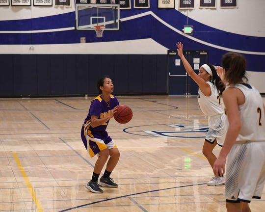 Salinas freshman Jenika Zurita (2), seen here in winter on the basketball court for the Cowboys, tried track for the first time this spring due to travel basketball starting later than usual.