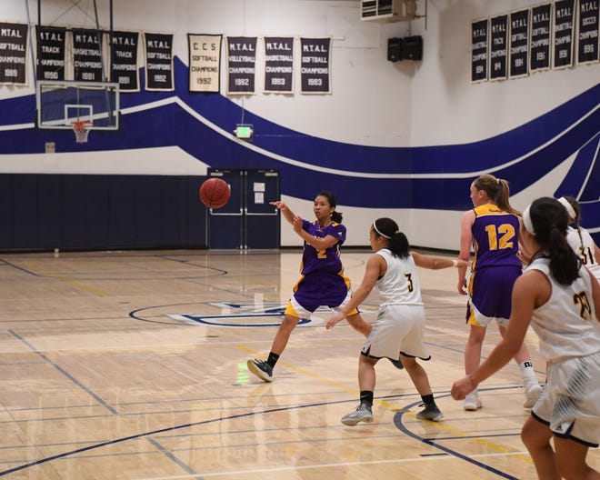 Salinas guard Jenika Zurita (2), though a freshman this winter, ran the offense from the point guard position for the Cowboys.